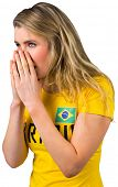 Nervous football fan in brasil tshirt on white background