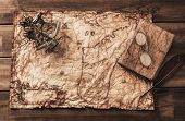 Sextant and logbook on a vintage map