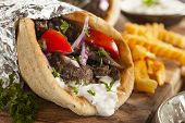 stock photo of pita  - Homemade Meat Gyro with Tzatziki Sauce tomatos and French Fries