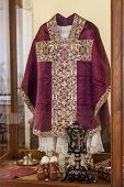 Mafra, Portugal - September 02, 2013: Clergy vestments - Chasuble, Rochet and Maniple. Mafra National Palace, Portugal.