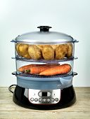 Healthy food in steamer, steam cooker with potatoes and carrots