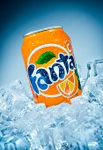 MOSCOW, RUSSIA-APRIL 4, 2014: Can of Coca Cola company soft drink Fanta Orange on ice. Fanta is a global brand of fruit-flavored carbonated soft drinks created by The Coca-Cola Company.