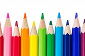 Row Of Colorful Pencils Isolated Over White Background