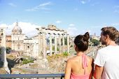 Roman Forum tourists looking at landmark in Rome sightseeing on travel vacation in Rome, Italy. Happ