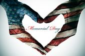 picture of holiday symbols  - memorial day written in the blank space of a heart sign made with the hands patterned with the colors and the stars of the United States flag - JPG