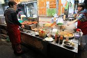 HONG KONG ISLAND, CHINA - JANUARY 2 : Street venders selling food at night on Lockhart Road in Hong