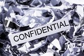shredded paper tagged confidential, symbol photo for data destruction, banking secrecy and confident