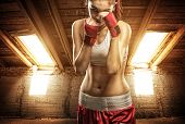 Young women boxing exercise in the attic