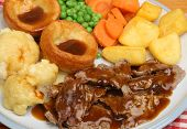 Roast lamb Sunday dinner with Yorkshire puddings.
