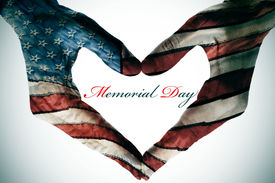 image of star shape  - memorial day written in the blank space of a heart sign made with the hands patterned with the colors and the stars of the United States flag - JPG