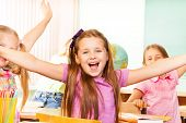 Happy Girl with arms apart laughs during lesson