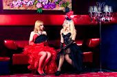 stock photo of moulin rouge  - Girl in the clothes of past years in style Cabaret Moulin Rouge - JPG