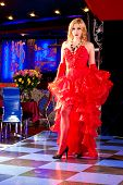foto of moulin rouge  - Girl in the clothes of past years in style Cabaret Moulin Rouge  - JPG