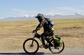 mountain bike rides along the   road in the high mountains of tibet, china