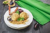 Delicious sweet plum dumplings on plate
