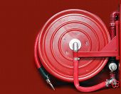 Firefighter Hose On The Red Background