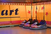 picture of amusement park rides  - Row of Bumper Cars for an Amusement Park Ride - JPG