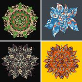 Collection of symmetric ethnic ornaments. Ornamental round floral pattern.