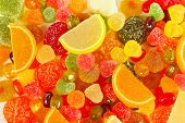 Background of colorful fruity candies and jelly closeup