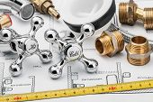 stock photo of plumbing  - plumbing and tools lying on drawing for repair - JPG