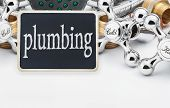 Plumbing And A Blackboard With The Text