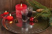 Christmas background with liquor, spices, candles and fir branches