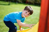 Little Boy Climbing On Slide