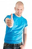 Portrait of young man with thumbs up isolated on white.