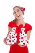 Happy isolated young woman holding gift boxes with red hearts for valentines day.