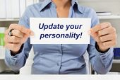 Hands of woman holding sign: Update your personality