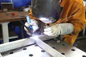 stock photo of welding  - Close up of craftsman welding - JPG