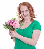 Red-haired woman with spring bouquet in hand