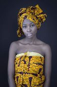 Portrait of a young African woman in traditional dress