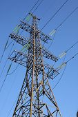 picture of transmission lines  - There is a power transmission line by an interesting angle of view under blue sky - JPG