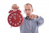 Eleventh hour - stressed man pointing at camera isolated on white background