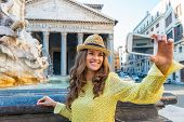 Young Woman Making Selfie Near Fountain Of The Pantheon In Rome, Italy