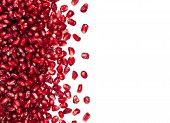 Scattered From The Side Pomegranate Seeds, Can Be Used As A Background, Isolated On A White