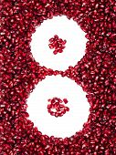 Scattered In The Form Of Eight Pomegranate Seeds, Can Be Used As A Background, Isolated On A White