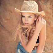 Beautiful Young Woman In  Straw Hat