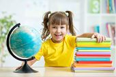 Portrait of kid girl considers Globe