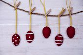Five Red Easter Eggs Hanging On Line