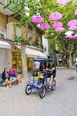Tourists On A Bicycle In The Resort Town Bellaria Igea Marina, Rimini, Italy