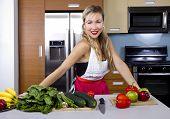 Blond Girl in a Kitchen