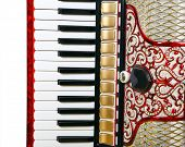 picture of outdated  - fragment musical instrument red accordion outdated device - JPG