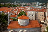 picture of red roof tile  - Ancient city of Budva with red tiled roofs and big orthodox church Montenegro - JPG