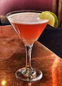 Pink Cocktail With Lime Wedge