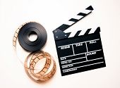 Unrolled 35Mm Movie Reel And Clapperboard In Vintage Color Effect