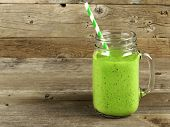 picture of masonic  - Healthy green smoothie in a mason jar mug on old wood - JPG