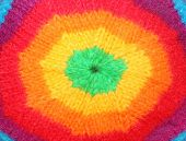 Closeup of rainbow rasta cap. Homemade knitted product. Fashion background.