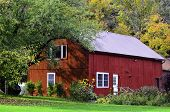 picture of red barn  - A view of a red barn in the country - JPG